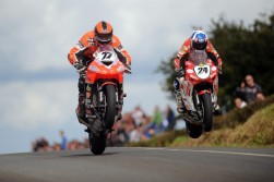 One of the things that make Irish road racing so outrageously spectacular are the jumps and the biggest jumps in the country are at Kells in Co. Meath. Ryan Farquhar (KMR Kawasaki) and Keith Amor (Craig Honda) battle it out in the Grand Final in 2009.