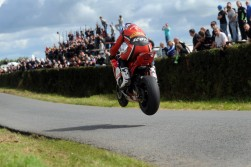 For me this is what road racing, and road racing photography, is all about. The crowd are only a few feet away- and I am even closer- as Keith Amor (Craig Honda) flies high over Hanlon's Leap at Kells Road races today in Co Meath.
