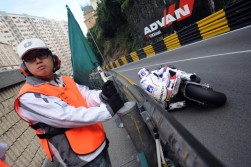My road racing season coverage comes to an end every year with a trip to China for the Macau Grand Prix. The only motorcycle race in the world to be run through the streets of a city, Macau's 3.8 mile course is lined by unforgiving armco barriers and concrete walls. The marshal seems unimpressed as Michael Rutter (Team of Paris Kawasaki) dodges under the armco exiting Melcoo during the opening qualifying session in 2009.