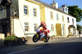 The evening sun is just beginning to fade as Gary Johnson gets the Robinson Concrete Honda airborne past the cottages at Rhencullen during a practice session for the Isle of Man in 2009. So much of motorcycle racing is shot on long lenses but I like to try to capture the action in these lovely settings on the wider optics. I couldn't have got the three legs of Man in in any other way!