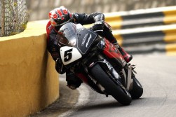 "I captured this shot of Steve Plater sliding his shoulder along the wall at Solitude Bends during my first trip to the Macau Grand Prix in 2003. The night before had been a heavy one and the hangover was still raging at 7.30am as I wandered up to the course to shoot the action. I had this in the can after a few minutes and to be honest I thought ""Jesus this Macau place is easy, it is like shooting fish in a barrel getting a good picture here."" I have been back many many times and have never captured anything like it since. It is called 'luck' and I thank the god of photography for the slice of good that he gave me every time I look at this shot."