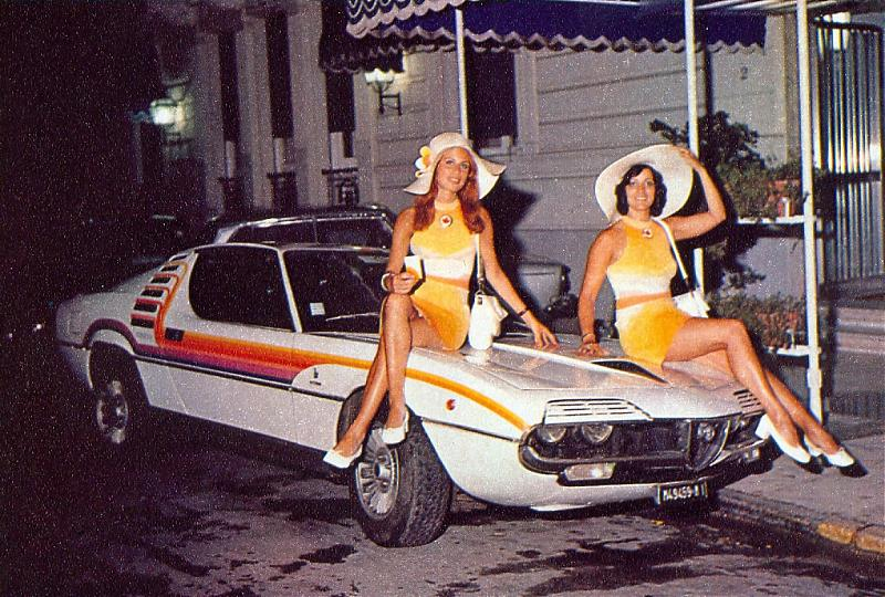 The Bertone-penned Alfa exotic didn't need floppy hatted booth babes to look killer