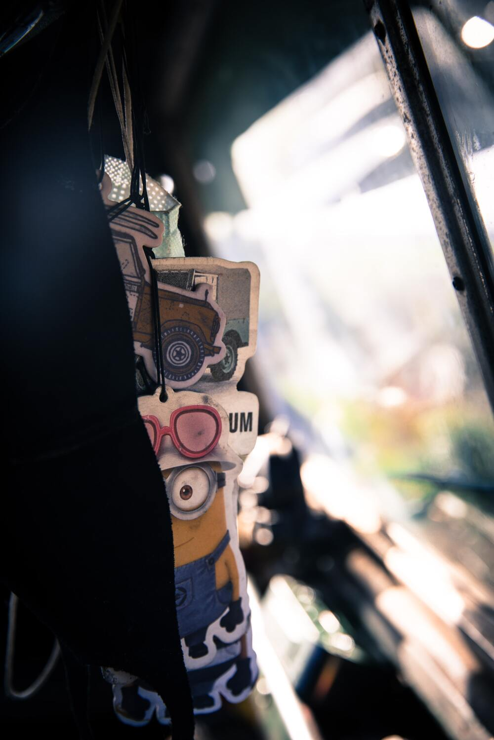A collection of air fresheners hangs inside the vehicle's interior.